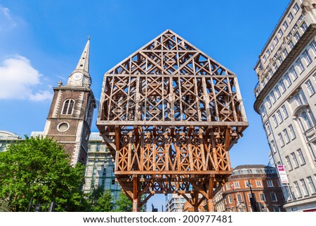 LONDON-MAY 18, 2014: timber frame sculpture. It is made from 17 cubic metres of larch and marks the place where the Aldgate once stood, that was the easternmost gate of the old wall of City of London