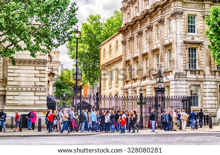 LONDON MAY 28: Tourists outside the gate of Downing Street in London on May 28, 2015. 10 Downing Street is the official office of the British Prime minister - stock photo