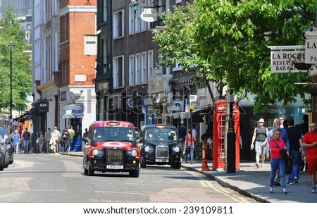 LONDON - MAY 15: Traditional London Taxi on the road in London on May 15.2014 in England - stock photo