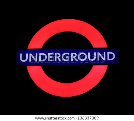 LONDON - MAY 03: Transport for London using the Underground illuminated logo , transportation systems in London on May 03, 2012 in London. - stock photo