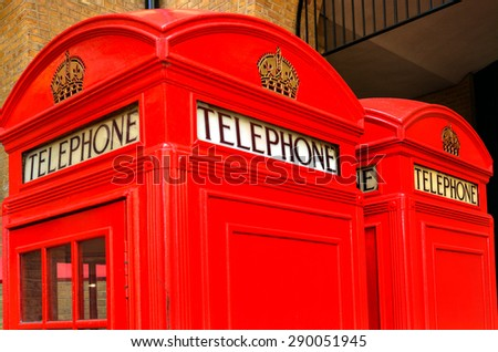 LONDON - MAY 13 2015:Two K2 kiosk Red telephone boxes in London, UK.Due to cost, around ���£35 14s 0d per kiosk, only 1,700 examples were installed by 1934, mostly in London. - stock photo