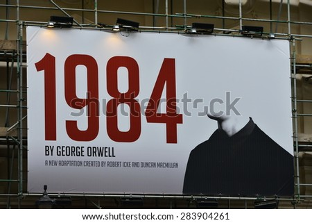 LONDON - MAY 30: View a billboard advertising Robert Icek and Ducan MacMillan's theatrical adaptation of George Orwell's Nineteen Eighty-Four on May 30, 2015 in London, UK. - stock photo