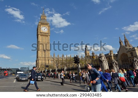 LONDON - MAY 14 2015:Visitors under the Big Ben clock tower. In 2012 - St. Stephen's Tower is renamed Elizabeth Tower in honor of Queen Elizabeth II's Diamond Jubilee, 60th anniversary on the throne. - stock photo