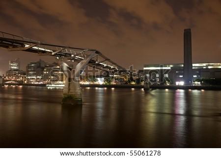 London Millennium bridge over river Thames and Tate Modern - stock photo