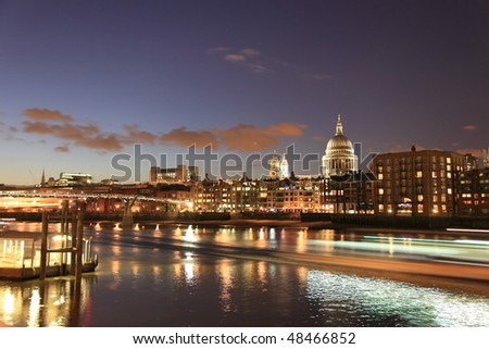 London night cityscape and Thames river, with light trails created by ferries - stock photo
