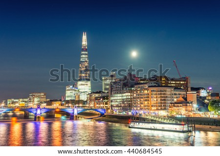 London night cityscape around Southwark, on the south bank of the River Thames near Tower Bridge. - stock photo