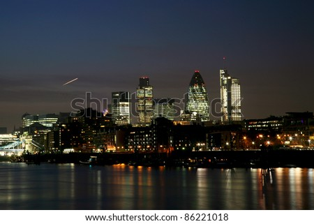 London Night View seen from North Bank of Tower Bridge - stock photo