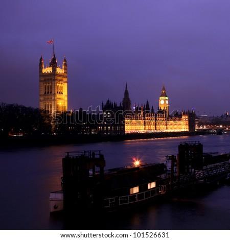 London night view, skyline, seen from Vaxuhall Bridge at dusk. - stock photo