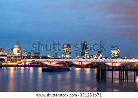 London nights from the piers with Canary Wharf view - stock photo