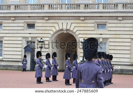 LONDON - NOV 28: British Royal guards performs the Changing of the Guard in Buckingham Palace on November 28, 2014 in London, UK - stock photo
