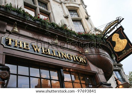 LONDON - NOV 11: English pub sign, Public house, known as pub, is focal point of the community, on Nov 11, 2010, London, UK. Pub business, now about 53,500 pubs in UK, has been declining every year - stock photo