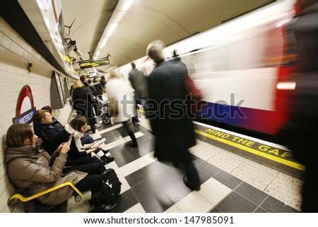 LONDON - NOV 10 : Inside view of London Underground, oldest underground railway in the world, covering 402 km of tracks, on Nov 10, 2012 in London, UK.   - stock photo