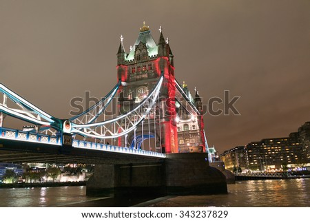 LONDON - NOV 5 : London Tower Bridge pictured at night on November 5th, 2015, in London, UK. Built in 1886, it is a combined bascule and suspension bridge in London over the River Thames.  - stock photo