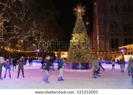 LONDON - NOV 7 : Night View of National History Museum Icr Rink on Nov 7, 2016, London, UK. Ice-skating people beating the winter cold at the famous Natural History Museum's annual Ice Rink .