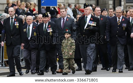 LONDON - NOV 8 : People take part in Remembrance Day Parade; nearst Sunday of 11 every Nov; to remember armed forces who have died since First World War; on Nov 8; 2015 in London; UK. - stock photo