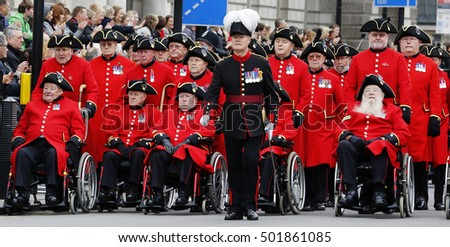 LONDON - NOV 8 : People take part in Remembrance Day Parade; nearst Sunday of 11 every Nov; to remember armed forces who have died since First World War; on Nov 8; 2015 in London; UK.