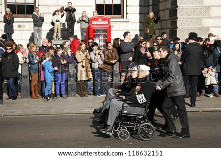LONDON - NOV 11 : People take part in Remembrance Day, Poppy Day or Armistice Day, 11th every Nov, to remember armed forces who have died since First World War, Parade on Nov 11, 2012, London, UK.
