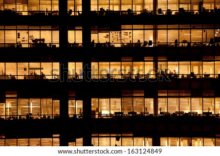LONDON - NOV 1: people work in an office building in London on November 1, 2013. Full-time employees in the UK work longer hours than the EU average, according to the Office for National Statistics. - stock photo
