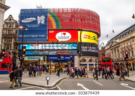 LONDON - NOV 5: Piccadilly Circus neon signs changed in late 2011 on November 5, 2011 in London U.K. Contracts above the famous neon expired after over 20 years as a recognizable symbol of the city - stock photo