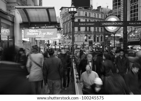 LONDON - NOV 13: Tourists in Piccadilly Circus, famous tourist attraction, road junction, built in 1819, links to West End, Regent Street, Haymarket, Leicester Square, on Nov 13, 2010 in London, UK. - stock photo