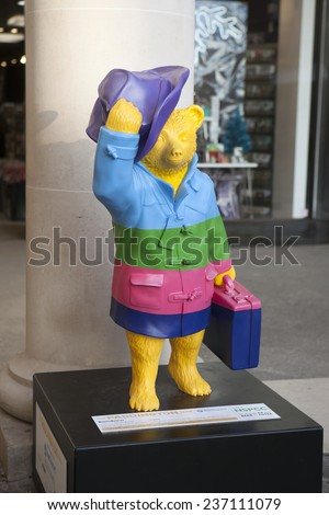 LONDON - NOVEMBER 4. A decorated street model of Michael Bond's fictional character Paddington Bear, on November 4, 2014, for later charity auction; one of 50 designs located across London.
