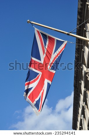 LONDON - NOVEMBER 10. A Union flag flying in Whitehall, a street of government buildings running between Parliament Square and Trafalgar Square on November 10, 2014 in London, UK. - stock photo