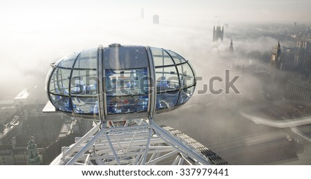 London - November 12, 2013: Bird Eye View, London Eye and Big Ben present,  seen from London Eye, a famous tourist attraction at a height of 135 metres (443 ft) and the biggest Ferris wheel in Europe. - stock photo