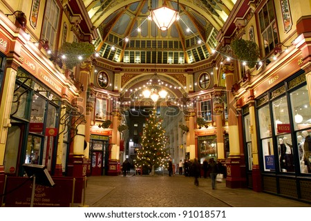 LONDON - NOVEMBER 30: Christmas decorations in Leadenhall Market (the building was designed at the end of the 19h century by Sir Horace Jones) on November 30, 1011 in City of London, London, UK - stock photo