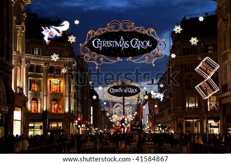 LONDON - NOVEMBER 22: Christmas lights on Oxford street, the busiest shopping area, on November 22, 2009 in London, England - stock photo