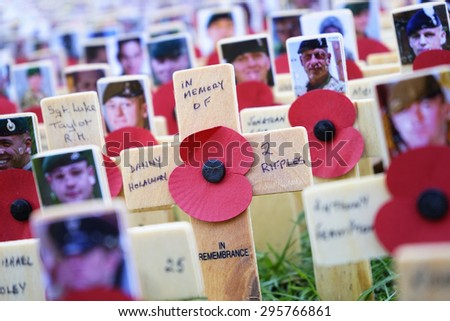 London - November 9, 2014: Poppies at the Westminster Abbey Garden of Remembrance, on Nov 9, 2014, London UK, to remember armed forces who have died since First World War. - stock photo