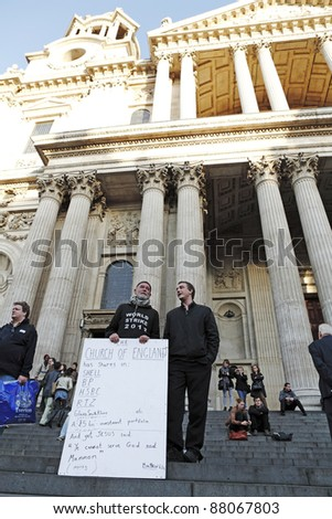 LONDON - NOVEMBER 1: Protesters with their protest placard participates at the Occupy London Stock Exchange anti-capitalist protest on November 1, 2011 at St Paul's Cathedral churchyard in London, England.