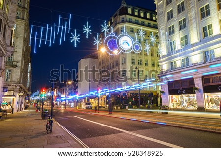 LONDON - NOVEMBER 27, 2016: Strand street with Christmas decorations and car light trails
