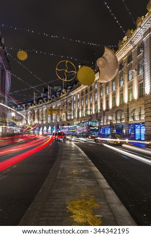 LONDON - NOVEMBER 26th 2015: This year's Regent Street Christmas lights feature shimmering golden sequins, cogs and coils which create a glittering setting for shoppers