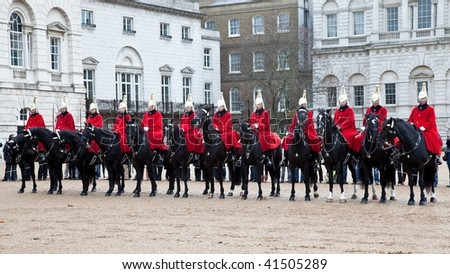 LONDON - NOVEMBER 22: the Royal Guards parade at the Admiralty House on November 22, 2009 in London, England - stock photo