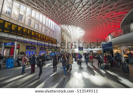 LONDON - NOVEMBER 6, 2016: Travelers pass through new departures concourse at King's Cross railway station, which is integrated with the St Pancras International Eurostar terminus.