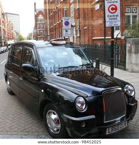 LONDON - NOVEMBER 23 : TX4 Hackney Carriage, also called London Taxi or Black Cab, at Strand on November 23, 2010 in London, UK. TX4 is manufactured by the London Taxi Company, LTC. - stock photo