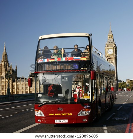 LONDON - OCT 27: London Sightseeing bus on October 27, 2012, London, UK. Open-top tour bus with audio guide, various languages available, is the great way see the London's major sights in short time. - stock photo