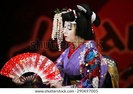 LONDON - OCT 5 : Participants, Hiroko Tanaka Nihon Buyo Team-Japanese dance, influenced by Kabuki dance, at 2013 London Japanese Matsuri (festival) at Trafalgar Square on Oct 5, 2013, London, UK.  - stock photo