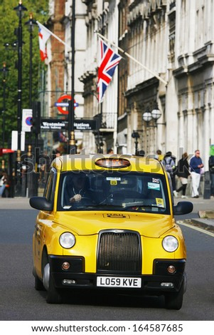 LONDON - OCT 30 : TX1, London Taxi, TX1, also called hackney carriage, black cab, on Oct 30, 2013 in London, UK. Traditionally Taxi cabs are all black in London but now produced in various colors.  - stock photo