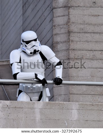 LONDON - OCTOBER 4, 2015.  A Stormtrooper, the fictional character from Stars Wars, poses at the National Theatre, the 1977 Brutalist building located at the Southbank, London, UK. - stock photo