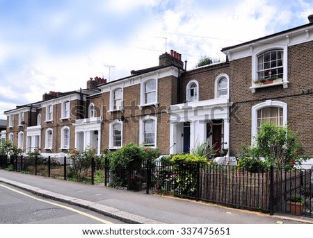 LONDON - OCTOBER 11, 2015. A terrace of nineteenth century, Victorian period, houses at Angel Walk in Hammersmith, west London, UK. - stock photo