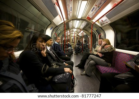 LONDON- OCTOBER 25: An interior view of a subway car at rush hour in London, England on October 25, 2009. London's system is the oldest underground railway in the world, dating back to 1863. - stock photo