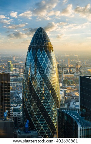 LONDON - OCTOBER 1: Gherkin building (30 St Mary Axe) during sunrise in London on October 1, 2015. 30 St Mary Axe building is one of architectural symbols of London, thanks to it's shape named Gherkin - stock photo