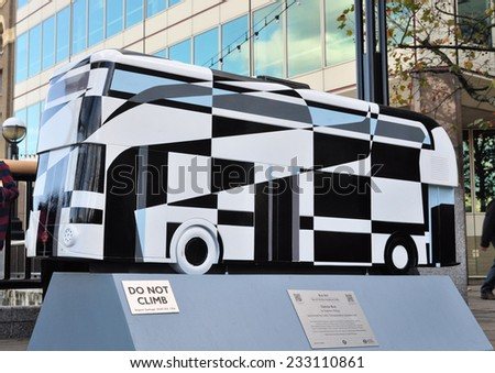 LONDON - OCTOBER 27. London celebrates the importance of its buses with 41 decorative bus models across the city on October 27, 2014; this one titled Dazzle by Stephen McKay by London Bridge, UK. - stock photo