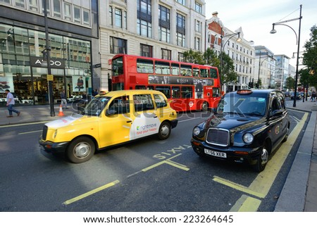 LONDON - OCTOBER 05: London Taxi on October 05, 2014 in London, UK. Traditionally Taxi cabs are all black in London but now produced in various colors. - stock photo