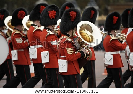 LONDON - OCTOBER 25: Marching the Queen's Guards during traditional Changing of the Guards ceremony at Buckingham Palace on October 25, 2012 in London, United Kingdom. - stock photo