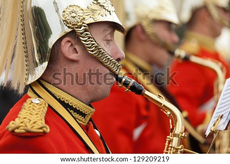LONDON - OCTOBER 18: Marching the Queen's Guards during traditional Changing of the Guards ceremony at Buckingham Palace on October 18, 2012 in London, United Kingdom. Trumpeters of the Royal Guard - stock photo