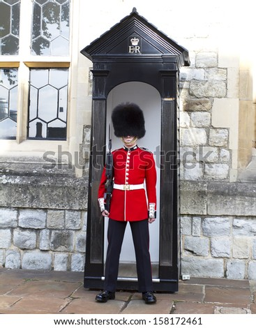 LONDON - OCTOBER 7 :Queen's Guard - Tower of London on October 7-10-2013. The Queen's Guard is the contingents of infantry and cavalry soldiers charged with guarding the official royal residences. - stock photo