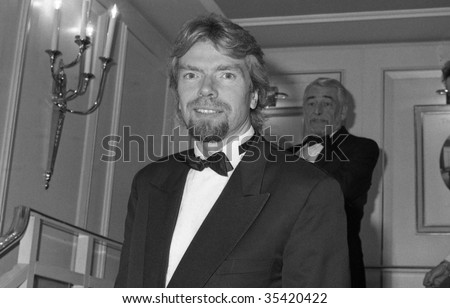 LONDON-OCTOBER 18: Richard Branson, Head of the Virgin group of companies, attends a celebrity event on October 18, 1990 in London. - stock photo