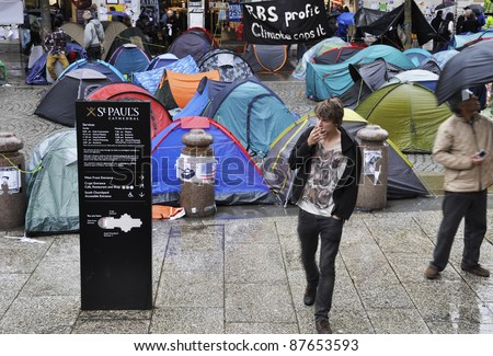 LONDON - OCTOBER 27: Since October 15, hundreds of Occupy LSX protesters have settled an encampment outside St Paul's cathedral on October 27, 2011 in London, England. LSX stands for London Stock Exchange. - stock photo